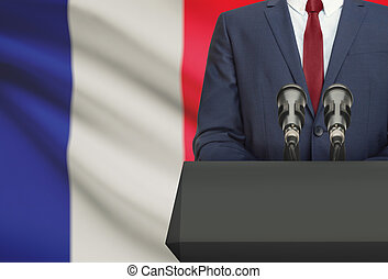 Businessman or politician making speech from behind a pulpit...