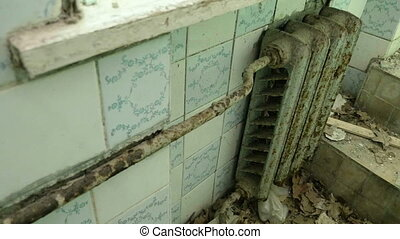 Radiator heating in the toilet of the abandoned house