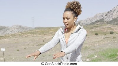 Pretty young woman working out in nature - Young pretty...