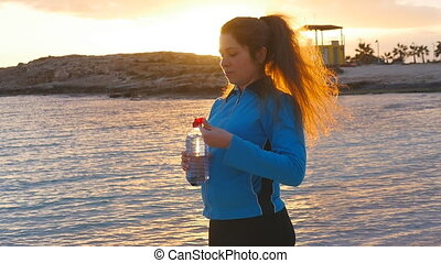 Fitness athlete woman drinking water - Beautiful fitness...