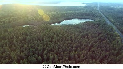 flying above autumn forest and lake - flying above beautiful...