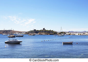 Luxury yachts, sailing and fishing boats in Bodrum bay....