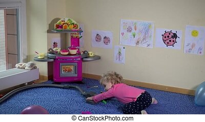 cute little girl with vacuum cleaner clean her room. Static...