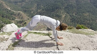 Sportive woman stretching body - Young fit woman wearing...
