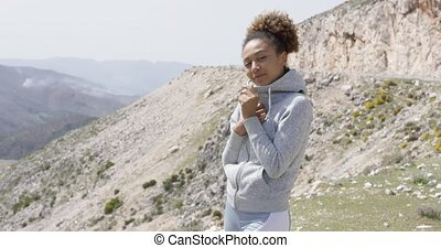 Young smiling sportive woman posing on nature - Smiling...