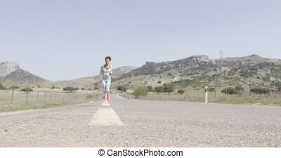 Young woman jogging - Young fit female wearing sportive...