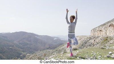 Meditating woman among natural views - Young flexible woman...