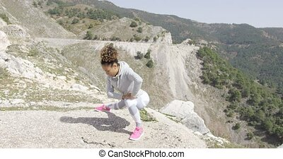 Flexible woman in sportswear stretching body - Young female...