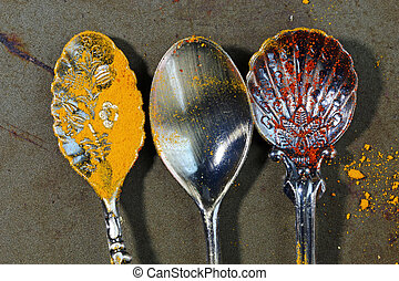 Empty spoons on a rustic background.