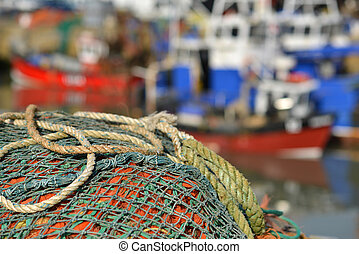 nets - Fishing nets on a jetty with fishing boats the...