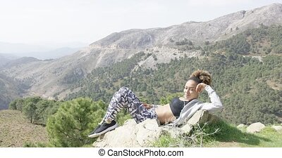 Relaxed young sportswoman taking rest - Young fit woman in...