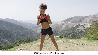 Young sportive female boxer - Young woman in sportive outfit...