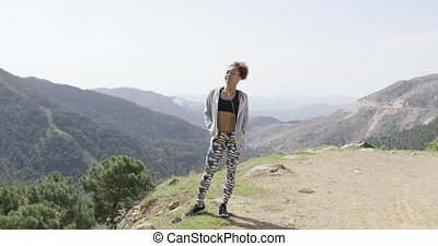 Delightful young sportswoman in mountains - Young happy...