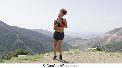 Fit content female in boxing gloves - Young sportive woman...