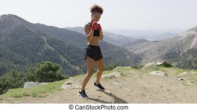 Young fit girl in boxing gloves - Young sportive female in...
