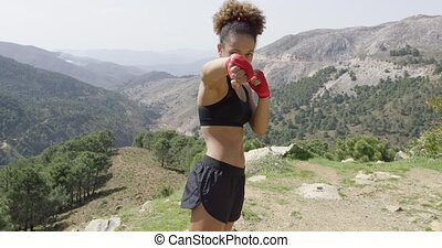 Young girl posing as boxer - Young woman in sportswear and...