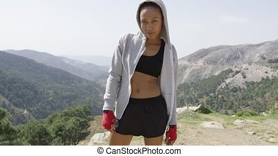 Young relaxed boxer against mountains - Young relaxed female...