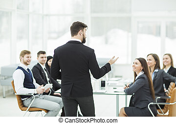 CEO speaks at the workshop business team in a modern office....