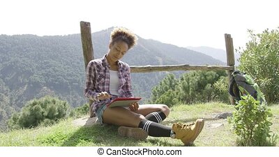 Delightful young backpacker with tablet - Young female...