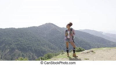 Female traveler backpacking in summer - Young fit woman...