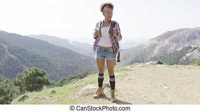 Happy young woman on top of mountains - Young sportswoman...