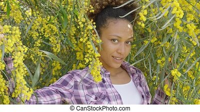 Young beautiful woman posing in trees - Smiling beautiful...