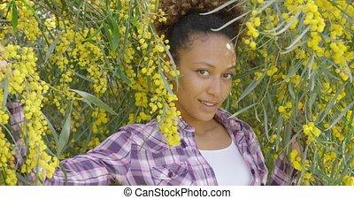 Young beautiful woman posing in trees - Smiling beautiful...