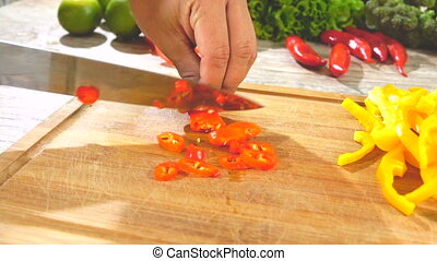 Red Pepper Slicing in slow Motion - slicing red pepper on...
