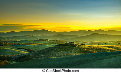 Volterra panorama, rolling hills and green fields at sunset. Tuscany, Italy