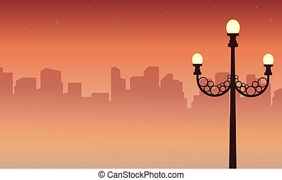 Street lamp scenery with city silhouettes