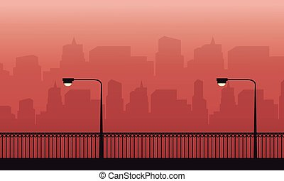 Silhouette of fence and lamp on the street scenery