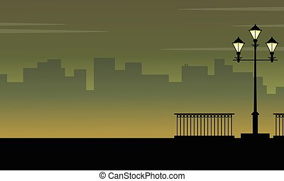 Silhouette of city background with street lamp landscape