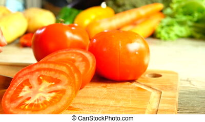 Slicing Tomato In Slow Motion - Close-up of tomato being...