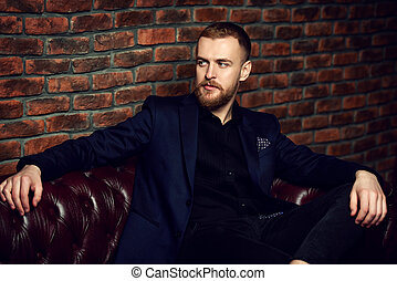 mature man - Imposing well dressed man sitting on a...