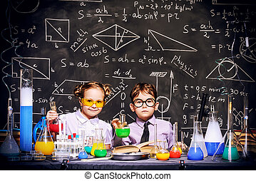 science choldren - Two little children scientists making...