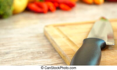 Panning of Tomato - Panning and close-up of tomato and knife...