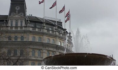 Flags of Britain on a background of a fountain.