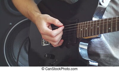Guitarist Playing An Electric Guitar At Home Studio. Black...