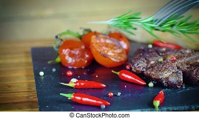 big tasty steak on stone plate - big tasty steak medium rare...