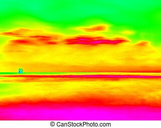 Infra. . Stony ocean beach with big boulders. Thermography...