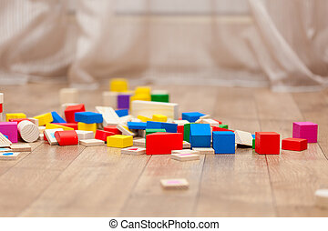 Colored children cubes on the floor