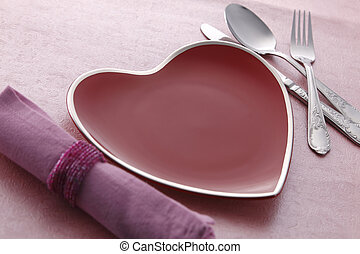romantic dinner - plate with love shape and  cutlery