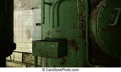 Boiler in the abandoned factory. Smooth and slow dolly shot.