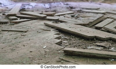 Broken parquet on floor in the abandoned hospital. Smooth and slow dolly shot