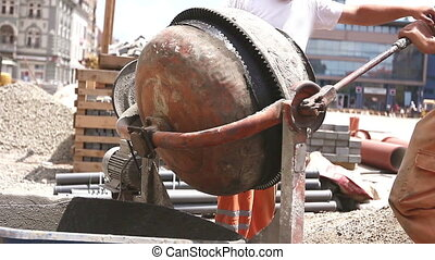 Discharge concrete mixer - Concrete is pouring from the...