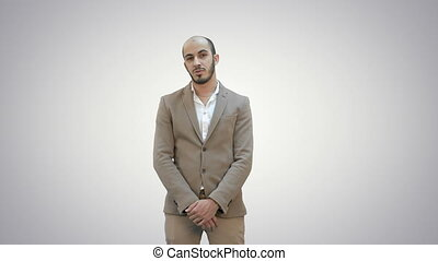 Businessman presenting project looking at camera on white background.
