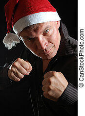 Aggressive Santa - portait of a man with a Santa hat and...