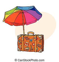 Rainbow colored, open beach umbrella and travel suitcase...