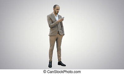 Businessman using mobile phone on white background.