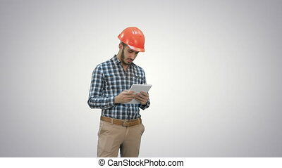 Modern engineer using a wireless tablet to check...